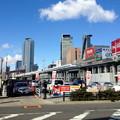 写真: 名駅ビル群をバックに走る新幹線 - 3