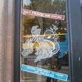 写真: advert from a shop window against fracking.
