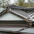 Photos: 個性的な鬼瓦と屋根の上の虎と龍
