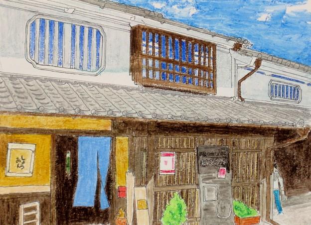 暖簾揺れ冬暖かき町家カフェ