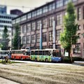 Photos: 熊本市役所花畑町別館前を走る九州産交バスと熊本バス。