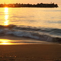 Photos: 夕陽に染まる日本海 波