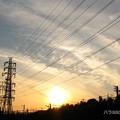 Photos: 夕焼け空と夕陽、高圧鉄塔の有る風景